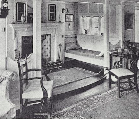 picture of a sitting room with seats centered around a fireplace